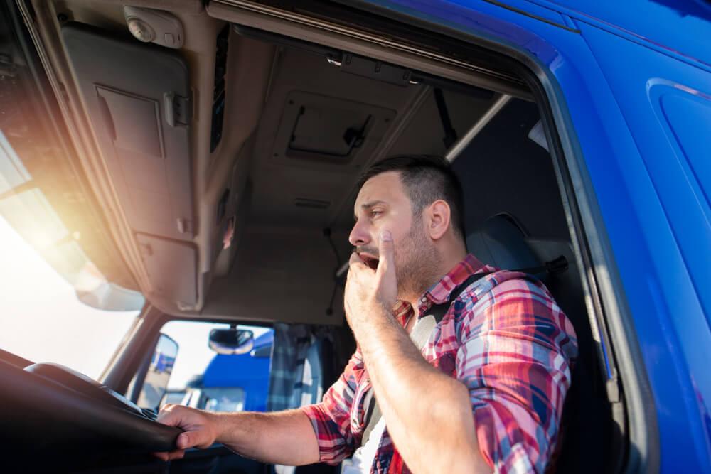 Truck driver yawning