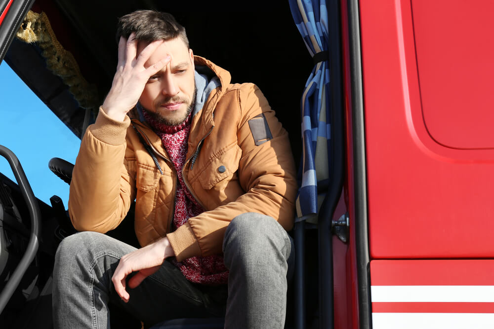 picture of an exhausted truck driver